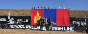 Peter, Max and James stand proudly at the finish of Mongol Rally 2014